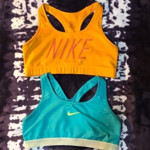 Orange and blue Nike sports bras
